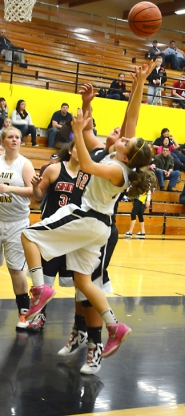 by: John Brewington DRIVING—St. Helens' Michelle Sass heads to the hoop during last week's home game with Sandy.