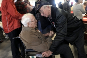 by: Jaime Valdez Russell Washburn, former Tualatin Fire Department Fire Chief, shakes hands with Ernest Metcalfe, a former Beaverton Fire Department captain at Saturday's celebration.