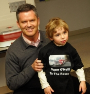by: vern uyetake Lake Oswego's Chris O'Neill gets reacquainted with 4-year-old Seve Prats Feb. 24, when O'Neill was honored for his efforts to save Prats after a car accident.