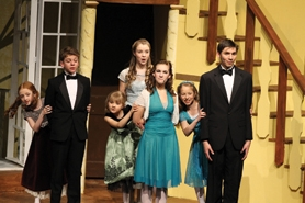 by: John Schrag The von Trapp children bid adieu to party guests during Forest Grove High School's spring musical production of 'The Sound of Music,' which continues its run this weekend in Ellen Stevens Auditorium. From left to right are Grace Malloy, Seth Berdahl, Lily Fisher, Lauren Hansen, Hannah Teninty, Hannah Berdahl and CJ Johnson.