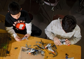by: Nick Fochtman Fourth-grader Gabriel Jahnsen (left) and fifth-grader Ben Svoboda work on their Lego Robotics projects last week at Bridger School, one of the after-school programs the PTA supports. The school's March 10 auction will raise funds to support art and music education.