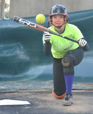 by: John Brewington PRACTICE BUNT—Scappoose's Cassidy Hoglund gets in a few bunts during hitting practice last week. Hoglund is a returning all-league third baseman.