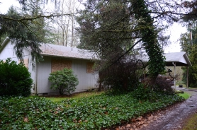 by: Vern Uyetake Lake Oswego owns this vacant and boarded-up home at 4315 Mapleton Drive in West Linn.