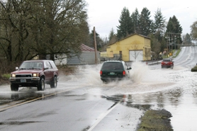 by: John Schrag Drivers rolled the dice on B Street in Forest Grove after heavy rains caused flooding across Washington County Thursday afternoon. Officials later closed the road.