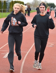 by: John Brewington TRACK CHAMPS—Scappoose's Charlie Davidson (left) and Tia Carnahan will anchor a powerful Lady Indians track team this season. Davidson is the reigning state 4A 1,500 meter champion.