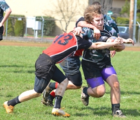 by: John Brewington HARD RUNNING—Josh Kellar of the Columbia County Operators' rugby team fights for yardage during last Saturday's match with Camas. The Operators lost the match, but are still in contention.