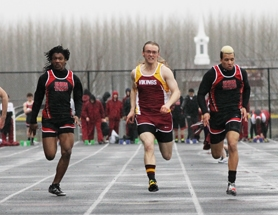 by: John Schrag Forest Grove senior Griffin Bailey runs against Union's Ryan Stanford during a meet on March 20.