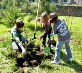by: contributed photo Several children plant a tree in honor of National Arbor Week and to recognize many efforts across the country to reforest our urban areas.