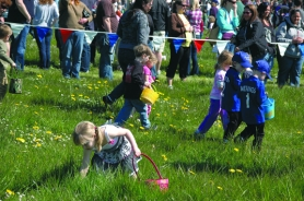 by: John Brewington Children scramble to grab their share of more than 30,000 plastic eggs scattered at the Columbia County Fairgrounds during last year's mEGGa Egg Hunt.