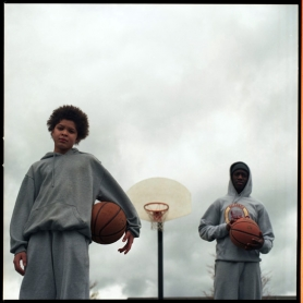 by: CHRISTOPHER ONSTOTT Rashaun Gavros, 11, (left) and Abdi Mas, 17, have grown up playing basketball and experiencing the good and the bad associated with the New Columbia neighborhood.