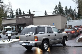 by: vern uyetake The Starbucks drive-through at Boones Ferry Road and Douglas Way has become a source of concern for the city, as customers waiting in cars to order coffee often spill over the sidewalk and block traffic.