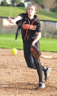 by: John Brewington FROM THE RUBBER—Scappoose's Lacey Updike throws a pitch during Monday's non-league encounter with Rainier. The Columbians posted a 6-0 win.