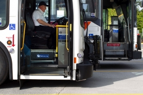 by: CHRISTOPHER ONSTOTT Training Supervisor Greg McGrew compares an old TriMet bus to one of the new buses, which has no steps to the seating area.
