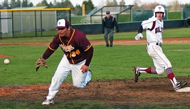 by: Dan Brood Tualatin senior Nathan Suyematsu rounds first base last Tuesday 