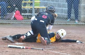 by: John Brewington SAFELY HOME—St. Helens' Brooke Cathers made it home as the ball got dropped during last Friday's game with Sandy. St. Helens came from seven runs down to take the lead, but in the end lost 10-9.