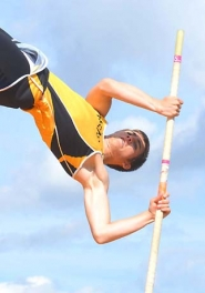 by: John Brewington WINNING VAULT—St. Helens' Austin Sandford cleared the bar here at 12-feet, 6-inches to take first in the Lower Columbia Inviational pole vault Saturday.