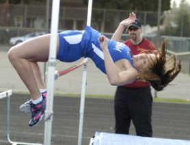 by: David Ball Gresham's Pearly Walton clears the bar on her way to first place in the high jump.