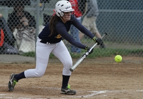 by: Chase Allgood Banks senior Natalie Larsen lays down a squeeze bunt during last Friday's game against Scappoose. The Lady Braves were leading when the game was stopped due to heavy rain, and it is scheduled to be made up today.