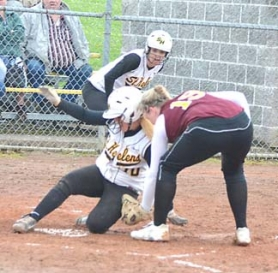 by: John Brewington ONE MORE RUN—St. Helens' Alyssa Giesbers slips home for a run during last Friday's game with Milwaukie.