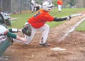 by: Brenda Lohman GOOD BUNT–Scappoose's Josh Ooley lays down a bunt during Friday's non-league game with Wilson. Scappoose lost the contest, 5-4.