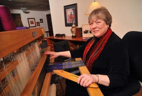 by: Vern Uyetake Bonnie Garlington is getting a lot of weaving done on her new computer operated loom. It has 40 harnesses and is capable of producing one million designs.