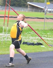 by: John Brewington JAVELIN-St. Helens Nick Dummer hurls the javelin during recent meet.