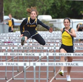 by: John Brewington, COMEBACK—St. Helens' Alyna Habel (left) came from behind to win the high hurdles during last week's meet with Parkrose.