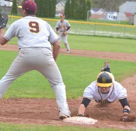 by: John Brewington, BACK SAFE—St. Helens's Tyler Stewart dives back to first during Wednesday's game with Milwaukie.