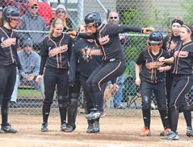 by: John Brewington, HOME RUN JUMP—Scappoose's Lexi Courtney gleefully jumps for the plate after a two-run homer during Friday's first game with Astoria. The Lady Indians scored 11 runs in the first inning on their way to an 11-1 win. They won the nightcap 9-5.