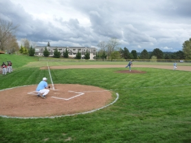 by: SUBMITTED PHOTO, Tony Fisher, who helped significantly with the planning of the new JV baseball field at Lakeridge, fired the first pitch before the first game on the field last week.