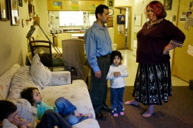 by: JAIME VALDEZ, Walter and Jilena Castillo, who live in this Tigard apartment with their children Robert, 7, Susan, 5, and Micaela, 3, are looking to buy a foreclosed home, but are miffed that the financial institutions selling those homes are trying to steer them to their in-house lending departments to make the purchase.