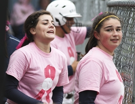 by: Chase Allgood, Banks teammates Natalie Larsen (left) and Madison Soper cheer from the dugout during last Friday's doubleheader against Tillamook.