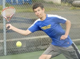 by: David Ball, Barlow's Caleb Cox stretches out for a return during his three-set match in singles play.