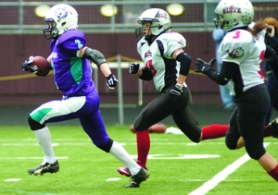by: David Ball, Portland running back Lauren Robideau breaks away from a pair of Utah pursuers for a 58-yard touchdown run in Saturday's 26-15 win.