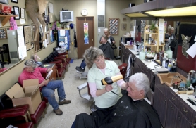 by: Jim Clark, Melodie Favara took over her father's barber shop after his death in 1997. The shop has been open since 1972.