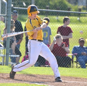 by: John Brewington, EYE ON THE BALL—St. Helens' Cody Galvin would hit this pitch for a single during Monday's game with Parkrose. St. Helens beat Parkrose in one game last week, but fell 15-5 in Monday's make-up game.