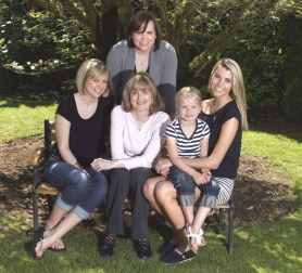 by: jim Clark, Terri O'Neill, center, in white, is No. 1 on the list for a heart transplant at Oregon Health & Science University. Shown with her are, from left, daughters Melissa Dickinson, Emily Stickley and Ashley Polston, who is holding granddaughter Caitlyn Stickley.