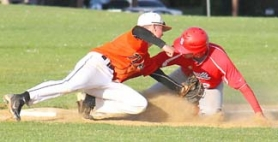 by: Submitted Photo, OUT AT THIRD—Scappoose's Nolan Lohman tags out a Seaside runner during Friday's game. The Indians won four games last week to clinch the Cowapa League title.