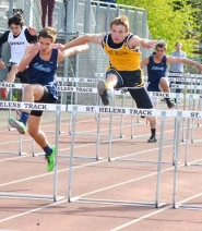 by: John Brewington, HURDLER—St. Helens' Thomas Hughes won both hurdle events at last weeks meet and will be a favorite at the district meet.