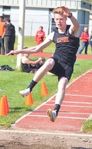 by: John Brewington, JUMPER—Scappoose's Mason Foumal won the long jump during Thursday's meet.