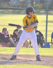by: John Brewington, JOYOUS SWING—St. Helens' Raymond Wise takes a cut in the last at-bat for the Lions during Friday's game with Sherwood.