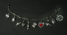 "by: Jim Clark, Local merchants are promoting ""Shop Local"" with a charm bracelet."