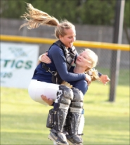 by: Chase Allgood, Banks catcher Aubrey Rue leaps into the arms of teammate Kaylin Vandomelen after the Lady Braves beat Yamhill-Carlton 2-0 last Tuesday.