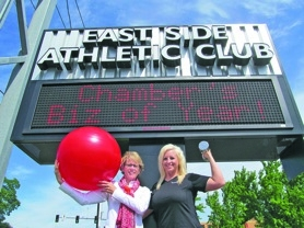 by: ellen Spitaleri, Terri Gilreath and Natalia Riley are pumped up over East Side Athletic Club being named the North Clackamas Chamber of Commerce Business of the Year 2012.