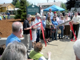 by: Jim Hart, There was nothing Dull in Boring midday Saturday when hundreds of Boring residents gathered around the community circle to celebrate the dedication of their new park: Boring Station Trailhead Park.