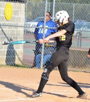 by: John Brewington, Sue Sass drives the ball for what would be a 3-RBI single on Thursday in St. Helens' 4-0 play-in win over Wilson. The Lady Lions travel to The Dalles on Wednesday for their first-round state playoff game.
