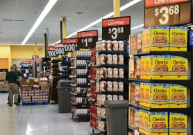 by: Vern Uyetake, Last week the shelves at the new Walmart will filling up with groceries. The store will hold its grand opening tomorrow at 8 a.m.
