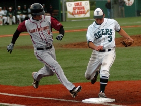 by: DAN BROOD, RACING — Tigard junior Robby Chabreck (right) gets to first base before Southridge's Chandler Whitney.
