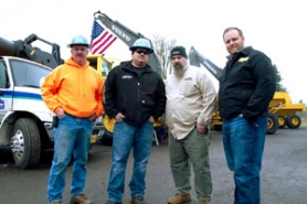 "by: Julius Kuziemski, (From left to right) Eric Ford, a shop tech at All-Ways Towing; Pat O'Malley, owner of All-Ways; Todd Hoffman, ""Gold Rush"" leader; and Jason Otteson, one of the crew's investors; pose for a picture at Buzzard's in Estacada."