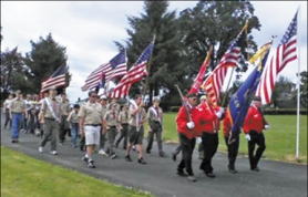 by: NANCY TOWNSLEY, The color guard procession is a feature of the Memorial Day ceremony at Forest View Cemetery held each year in Forest Grove.